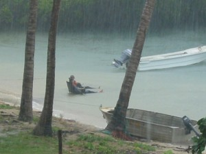 Boys from Weipa sitting in the rain